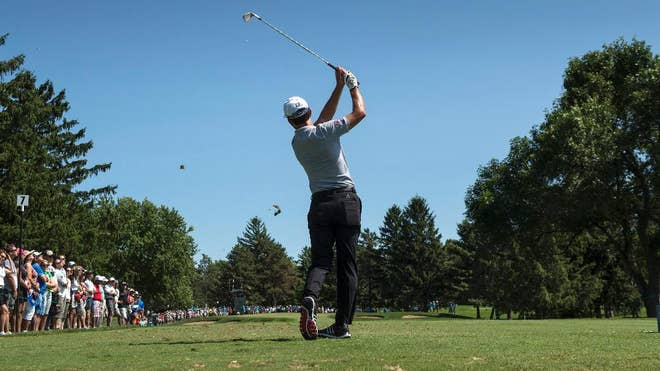 Michael Putnam and Tim Petrovic shared the first-round lead in the Canadian Open on Thursday, shooting -under  in sunny conditions at rain-softened Royal Montreal.