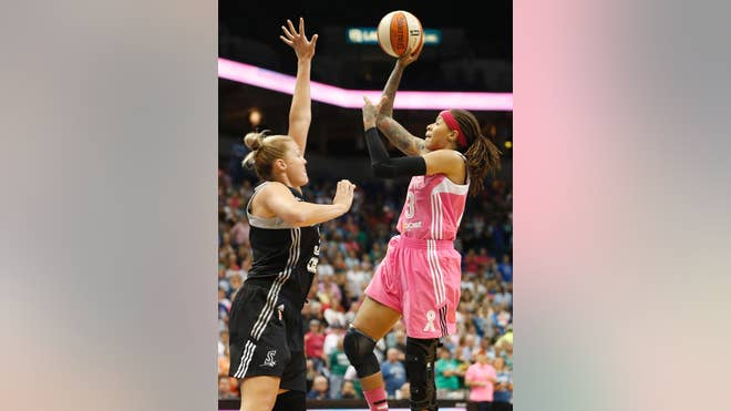 Seimone Augustus scored  points in her return from a knee injury and the Minnesota Lynx beat the San Antonio Stars - on Friday night for their sixth straight victory.