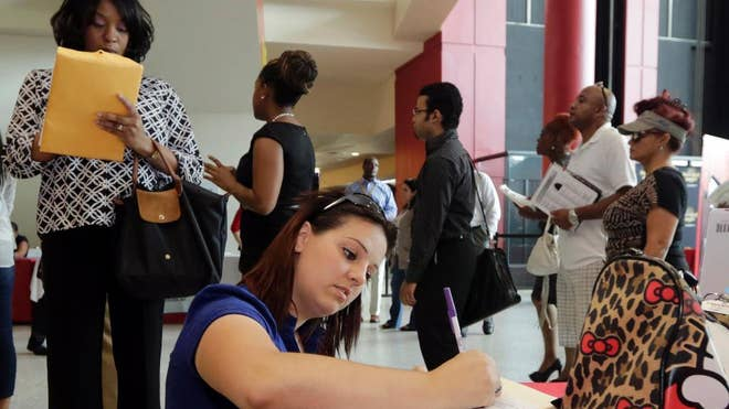 The number of Americans seeking unemployment benefits slipped , last week to a seasonally adjusted ,, a low level that signals employers are cutting few jobs and hiring is likely to remain strong.