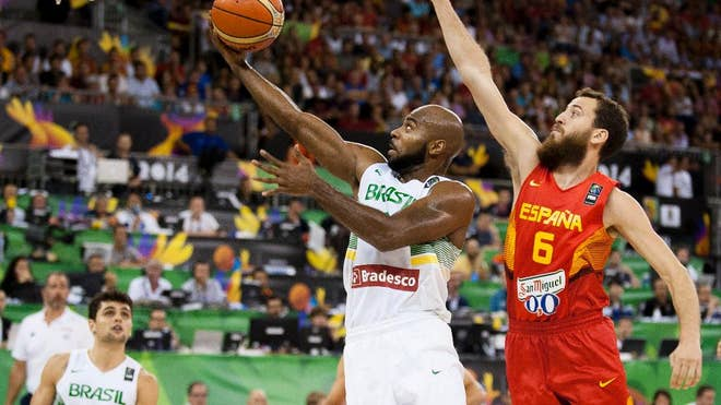 Spain beat Brazil in a battle of unbeatens to take the lead in Group A, while Greece also improved to - in a Group B that Senegal shook up with the big upset Monday at the Basketball World Cup.