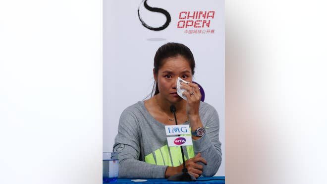 Two days after announcing the end of her momentous tennis career in an open letter to friends and fans, Li Na entered her farewell news conference with the appearance of somebody who had been crying.