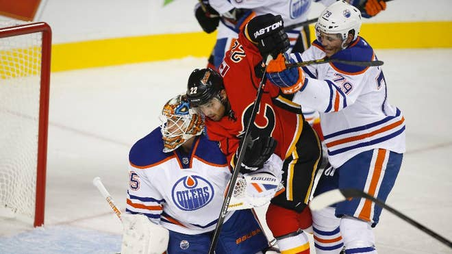 TJ Brodie scored on a power play : into the second period in the Calgary Flames' - victory over the Edmonton Oilers in a split-squad exhibition game Sunday night.