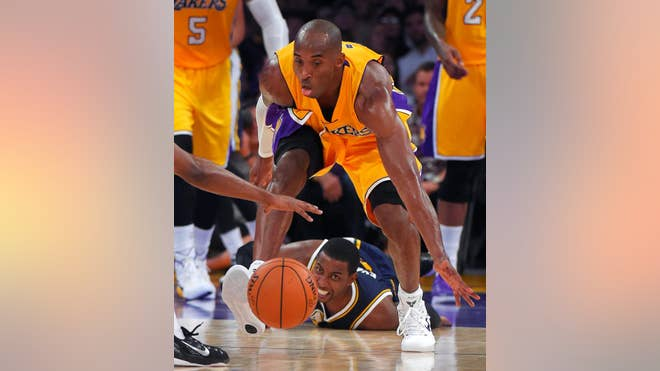 Kobe Bryant scored  points and Carlos Boozer added , leading the Los Angeles Lakers to a - preseason victory over the Utah Jazz on Sunday night.