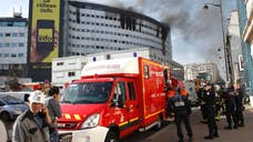 A fire at the Paris headquarters of French state radio is sending columns of thick black smoke out of more than a dozen windows Photos of the scene Friday afternoon show smoke pouring from the upper stories of the massive Maison de la Radio in the capital's th arrondissement.