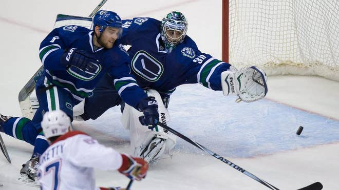 Daniel Sedin scored a power-play goal : into overtime, off an assist from twin brother Henrik, and the Vancouver Canucks bounced back from a blown lead and beat the Montreal Canadiens - on Thursday night.