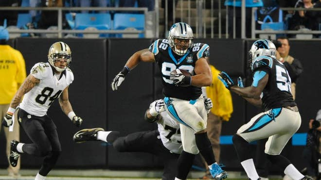 Drew Brees leapt forward and stretched the ball over the goal line on a fourth-down sneak to give the New Orleans Saints a - lead over the Carolina Panthers after the third quarter of Thursday night's game.