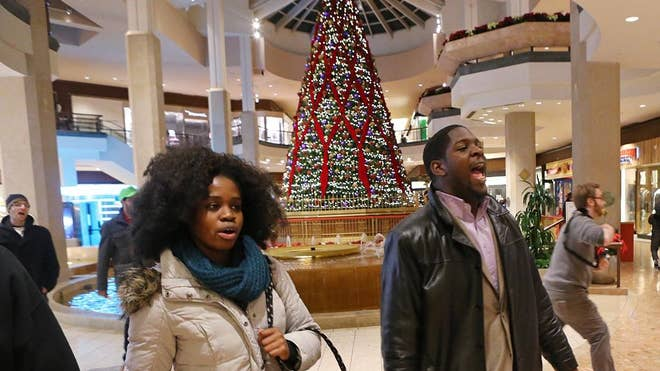 Protesters turned out in several U.S. cities on one of the busiest shopping days of the year Friday in response to a grand jury's decision not to indict the police officer who fatally shot -year-old Michael Brown in Ferguson, Missouri.