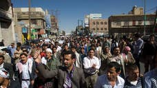 Shiite rebels armed with knives and batons have attacked and detained demonstrators trying to protest against them in Yemen's capital.