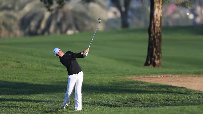 Rory McIlroy bogeyed the final hole to miss out on a share of the clubhouse lead during the first round of the Dubai Desert Classic on Thursday.