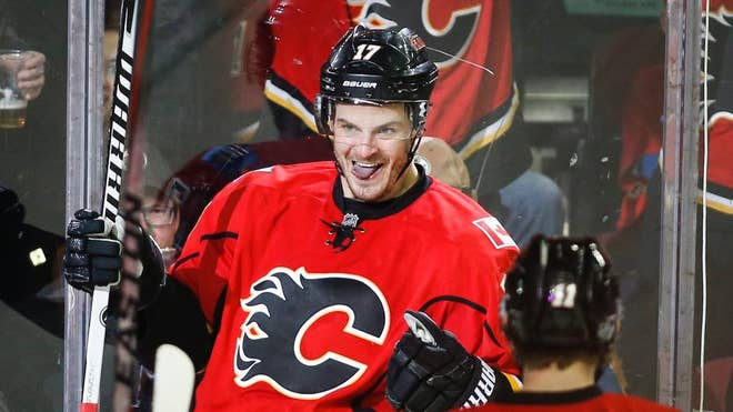 Lance Bouma scored two of Calgary's four third-period goals and the Flames stormed back for a - victory over the Edmonton Oilers on Saturday night.