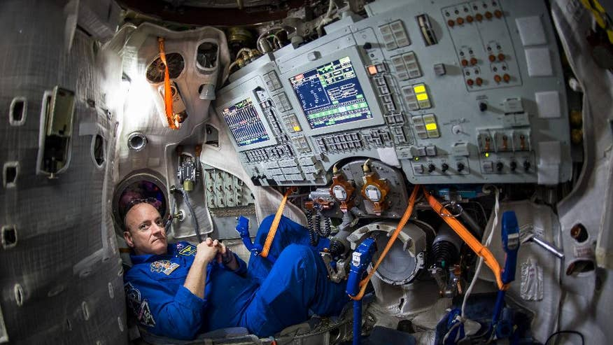 American, Russian leave Earth this week for year in space