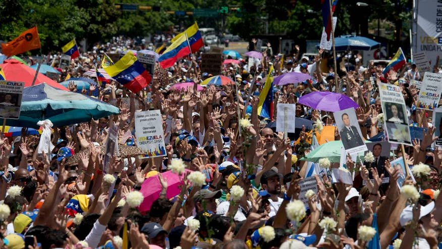 Venezuelans rally to protest socialist administration, demand date for legislative elections