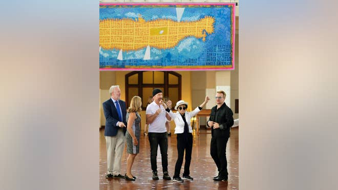 Standing in front of artwork depicting Manhattan as a yellow submarine and John Lennon as the pilot displaying the peace sign, Yoko Ono joined Bono and other guests to honor her late husband Wednesday.