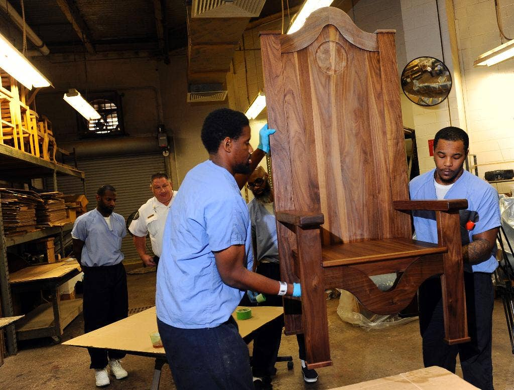Inmates work to carve upholster chair for pope francis