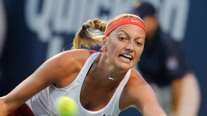 Second-seeded Petra Kvitova beat third-seeded Caroline Wozniacki -, - on Friday night to reach the Connecticut Open final for the fourth consecutive year.