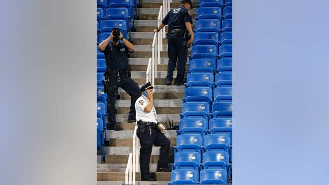 A New York City teacher has been arrested for allegedly crashing a drone into an empty section of seats at the U.S Open.