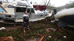 Residents of Australia's cyclone-battered tropical northeast emerged from their homes on Wednesday to find roofs lying in their yards, boats flung onto rocks and roads blocked by tangles of fallen trees and power lines, as emergency officials tried to reach communities cut off by the powerful storm.