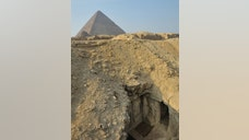 A wall painting, dating back over , years, has been discovered in a tomb located just east of the Great Pyramid of Giza.