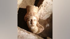 Archaeologists have discovered the missing head of one of the two marble sphinxes guarding a huge Macedonian tomb under excavation in Amphipolis, Greece