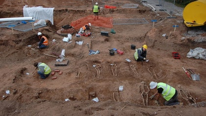 The skeletal remains of about  medieval individuals have been discovered in shallow graves near the pilgrimage site of a famous seventh-century saint in England