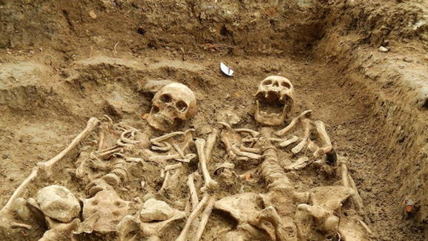700-year embrace: Skeleton couple still holding hands