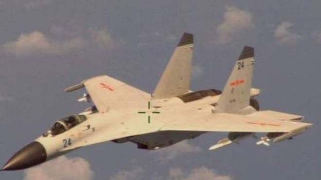 A Chinese fighter jet made several quotdangerousquot passes near a Navy P-A Poseidon intelligence and reconnaissance aircraft.,The Pentagon protested Friday against Tuesday's quotvery close, very dangerousquot intercept by a Chinese fighter jet of a U.S. Navy P-A Poseidon aircraft over the South China Sea off the Chinese island of Hainan.