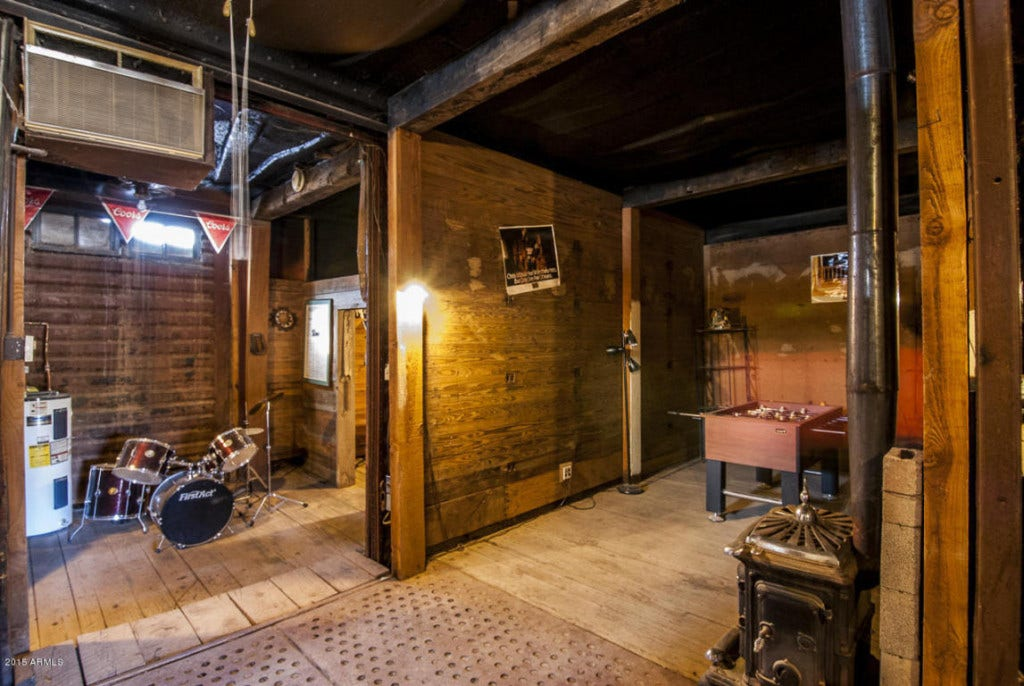 Buried railroad cars make for a monumental man cave in for Basements in arizona