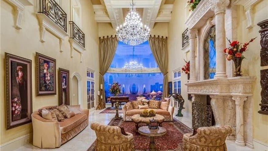 kenny-king-marble-fireplace-e147283-7cbd72be45ce6510VgnVCM100000d7c1a8c0____