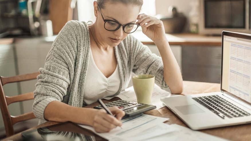 woman-paying-mortgage-778669502da07510VgnVCM100000d7c1a8c0____