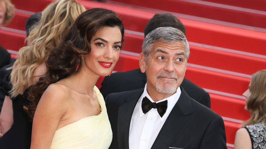Amal-and-George-Clooney--ce6caf0c363c7510VgnVCM100000d7c1a8c0____