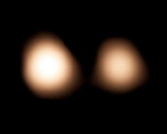 Charon Moon: NASA Probe Sees Pluto And Its Moon Charon Like Never