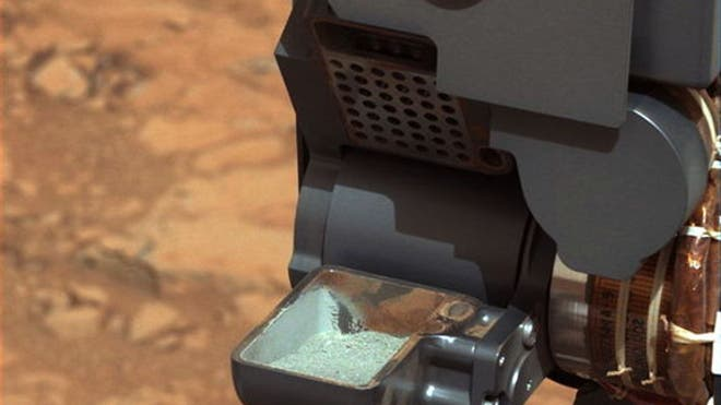 Curiosity rover shows first drill sample scoop of Mars