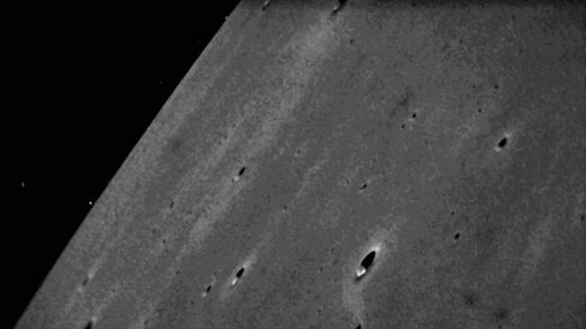 NASA probe beams Its 1st lunar photos to Earth