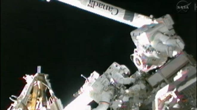spacewalk-hoshide-robotic-arm