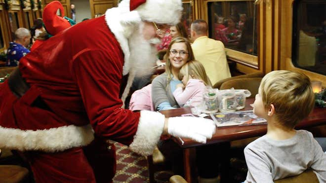 Santa visits with rail riders on the Polar Express