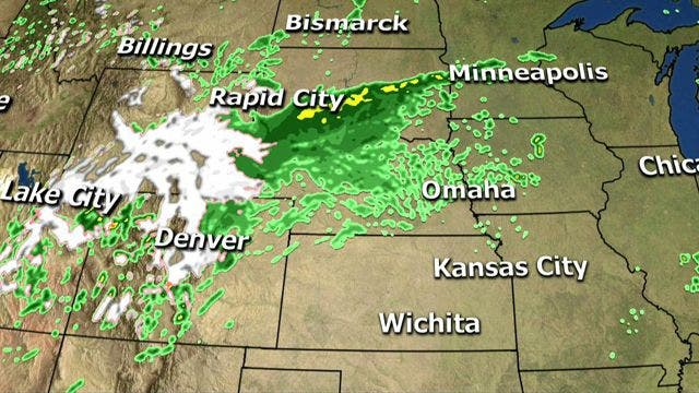 Spring storm hits Rockies with snow, Midwest with thunderstorms, tornadoes