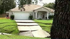 At least one home in Florida has been evacuated due to a -foot-wide sinkhole that some residents are concerned will spread to adjoining properties.