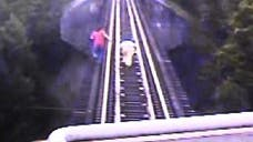 Two women in Indiana narrowly escaped death earlier this month when they found themselves trapped on a railway bridge -- right as a ,-ton freight train was bearing down on them.