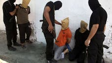 A witness and Hamas media say that masked gunmen have killed seven suspected informants for Israel near a Gaza City mosque as worshippers were ending midday prayers.
