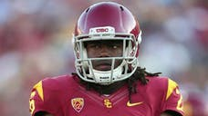 The story of the University of Southern California football star who said he injured both ankles jumping off a balcony to save his nephew from drowning on Saturday night is coming under closer scrutiny after an incident at a Los Angeles apartment complex.