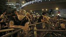 Hong Kong's chief executive urged pro-democracy protesters to stop their campaign immediately Tuesday after demonstrators gave the Chinese government a Wednesday deadline to meet their demands for political reforms.