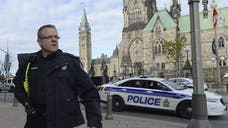 The man who stormed Canada's government complex Wednesday, killing a soldier and sending Ottawa into an all-out panic, had recently applied for a passport and was hoping to leave for Syria, his mother told Canadian authorities.