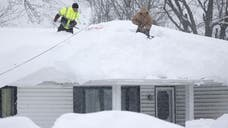 A new blast of snow pounded the Buffalo area Thursday, piling more misery on a city already buried by an epic, deadly snowfall that has left some areas with more than  feet of snow.