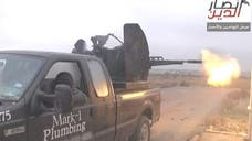 A Texas plumber has been receiving threats after a photo emerged of Islamic extremists in Syria firing a high-powered gun off the back of a black pickup truck with his company's decals on the side door.