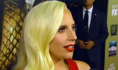 Super Bowl  hadn't even started, and it already had a showstopper: Lady Gaga.Mother Monster looked appropriately patriotic in an all-red Gucci two-piece -- glittery, of course -- as she performed the National Anthem alongside a piano accompanist on one of the biggest stages in music and NFL history.
