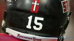 Arkansas State University called an audible and decided to reverse its decision banning memorial crosses that football players had placed on their helmets to honor two fallen teammates.