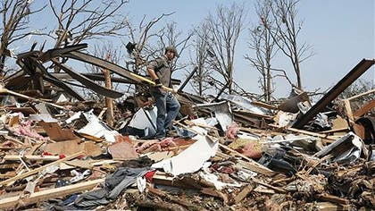 A massive tornado at least a half mile-wide with mph winds churned through Oklahoma City's suburbs Monday afternoon, flattening entire neighborhoods and destroying an elementary school with a direct blow as children and teachers huddled against winds up to  mph. At least  people were killed, and officials said the death toll was expected to rise.