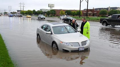 Widespread flooding caused by heavy rains in Texas and Oklahoma left  dead and  missing or unaccounted for, in addition to more than , damaged properties and , abandoned vehicles in the Houston area alone, Mayor Annise Parker said Tuesday afternoon.