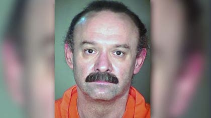 Arizona Gov. Jan Brewer ordered a review of the state's execution process after a convicted double murderer gasped and snorted for more than an hour and a half before his death Wednesday.
