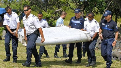 A wing flap suspected to be from the missing Malaysia Airlines Flight  on Saturday arrived at a French military testing facility where it will be analyzed by experts.
